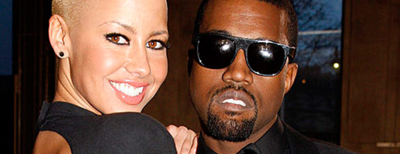 Amber Rose og Kanye West på Yves Saint Laurent-show under Paris Fashion Week i 2009 (Michel Dufour/WireImage)